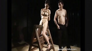 Wooden Bondage And Knocker Torment  Of Japanese Sub  Chick